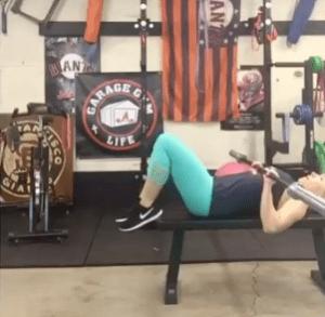 Robin Savala benching in her garage gym