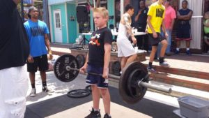teenager deadlifting at a charity unsanctioned powerlifting event