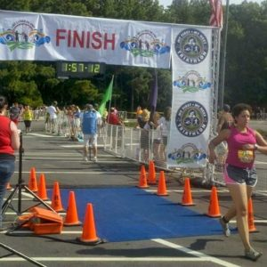 Garage Gym Life co founder Naomi Greaves running through the finish line