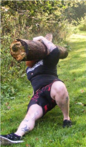 Gilligan's Island workout Phil Bennett doing a get up with a log