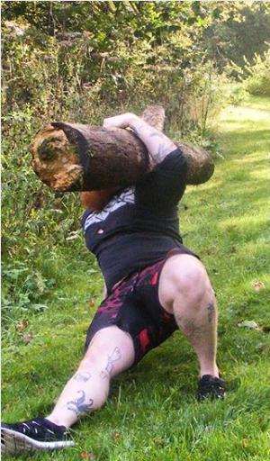 Phil Bennett doing a get up with a log