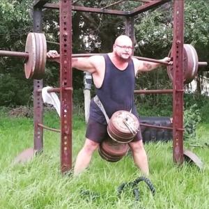 Bud Jeffries doing a combination belt squat and back squat