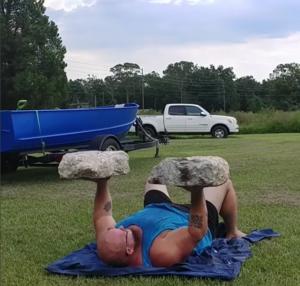 Bud Jeffries floor pressing two large stones