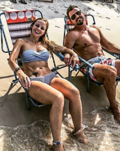 Shed gym owner Charles Forbus and his wife Jodie relaxing on the beach