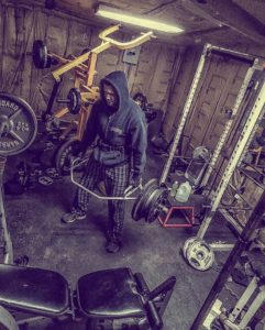 Charles Forbus trapbar deadlifting in his shed gym