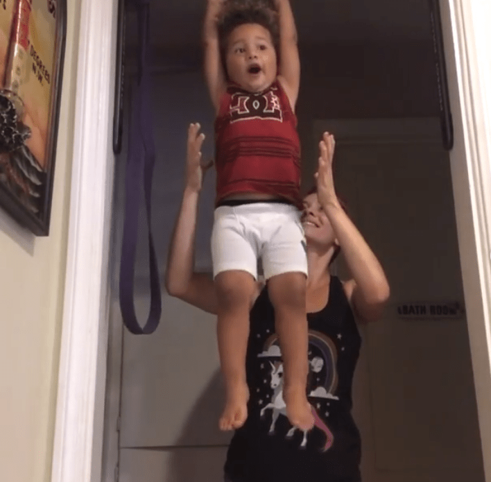 Christina Jogoleff exercises with her son