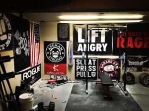 The deadliftpro6 uses banners on the wall of his garage gym to motivate himself