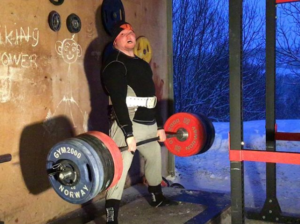 IPF Nordic Champion Erik Røen deadlifting in his Viking cave
