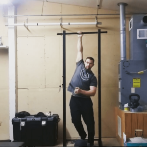 Wim Hoff Method student Rob Brinkley stretching in his garage gym