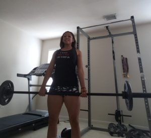 Val Airing holds the bar during deadlift