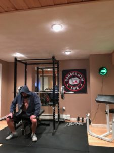 Paul Walsworth prepares for a set in his basement gym