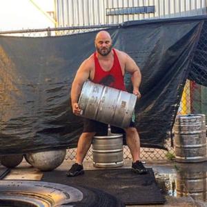 Dennis Cornelius using kegs