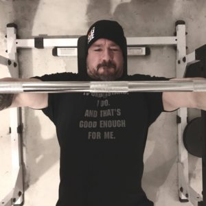 GDiesel benching in a Garage Gym Life t shirt