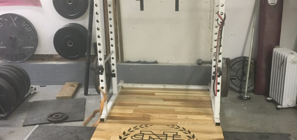 lifting platform at North Street Strength, a private powerlifting gym in Granby, MA.