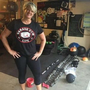 Michelle Simpson Pn2 in her garage gym