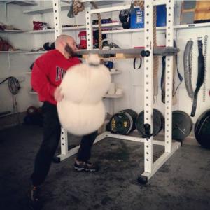 Ross Enamait loading a sandbag