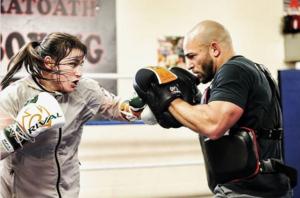 Ross Enamait and WBA World Lightweight Champion Katie Taylor working on the mitts