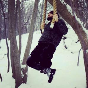 Ross Enamait doing pullups in the snow