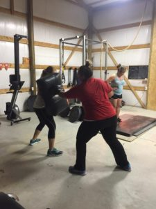 Anna Woods running a training class in her home gym