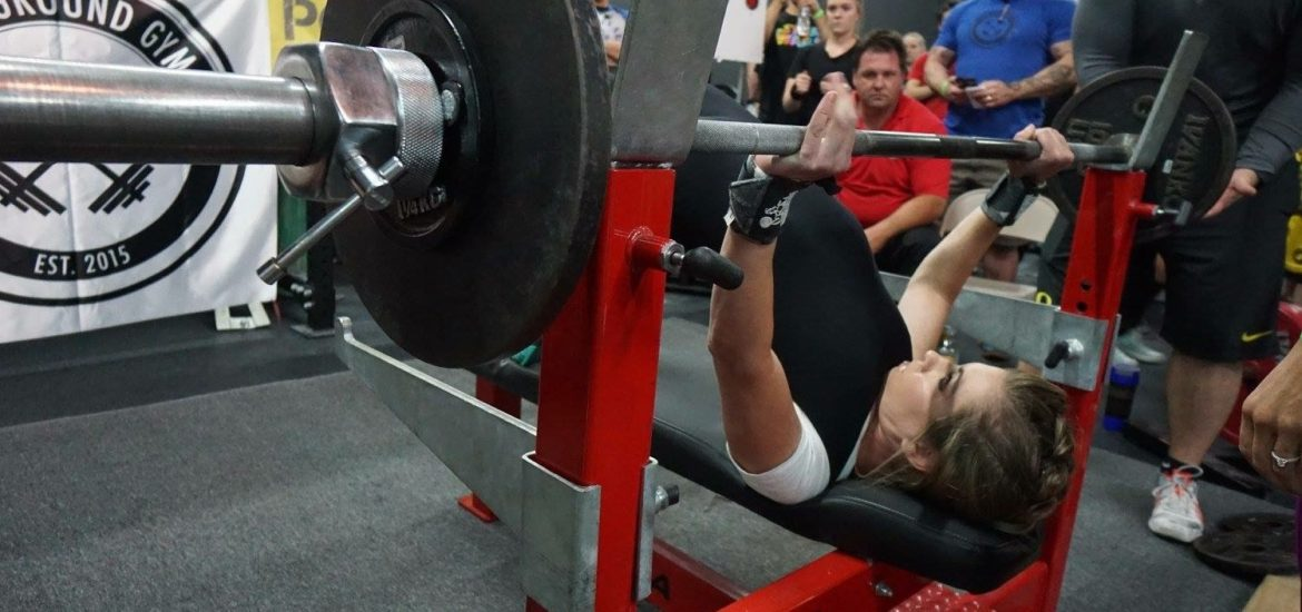 FitBliss coach Natalie Suaz benching in competition