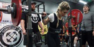 FitBliss coach Natalie Suaz squatting in competiton