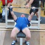 Ed Eliason benchpressing in a powerlifting meet