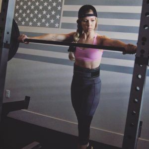 FitBliss coach Natalie Suaz prepares to squat