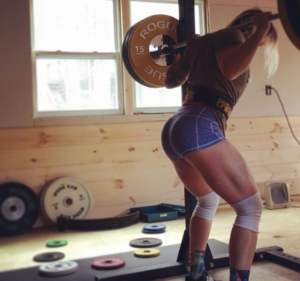 Kristin Pope squatting in her garage gym