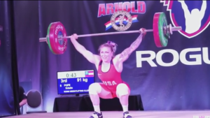 Kristin Pope hitting a PR snatch at the 2018 Arnold Fitness Expo