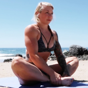 Kristin Pope stretching on the beach