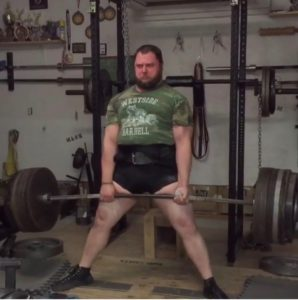 Single Ply powerlifter Sammy Sebok deadlifting in his garage gym