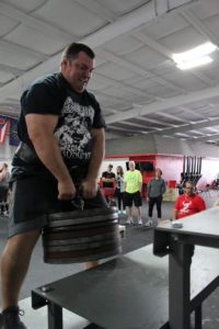 Rocco Walsh doing power stairs in a strongman competition