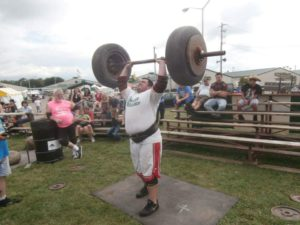 Rocco Walsh does Axle Press in a strongman competition