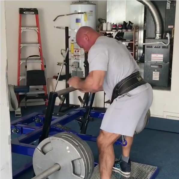 stan efferding uses his belt squat machine in his garage gym