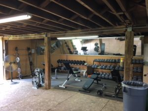 Dumbell rack and utility benches at BarnFit Gym