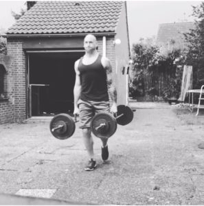 Tim Geurts doing farmers carries as part of his training for obstacle course races and for life