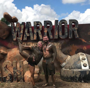 Brandis Atwood and her husband after a Warrior Dash