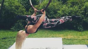 Brandis Atwood using the aerial hoop in her backyard
