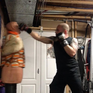 Rich Dlin doing some cardio with the help of a B.O.B. punching dummy