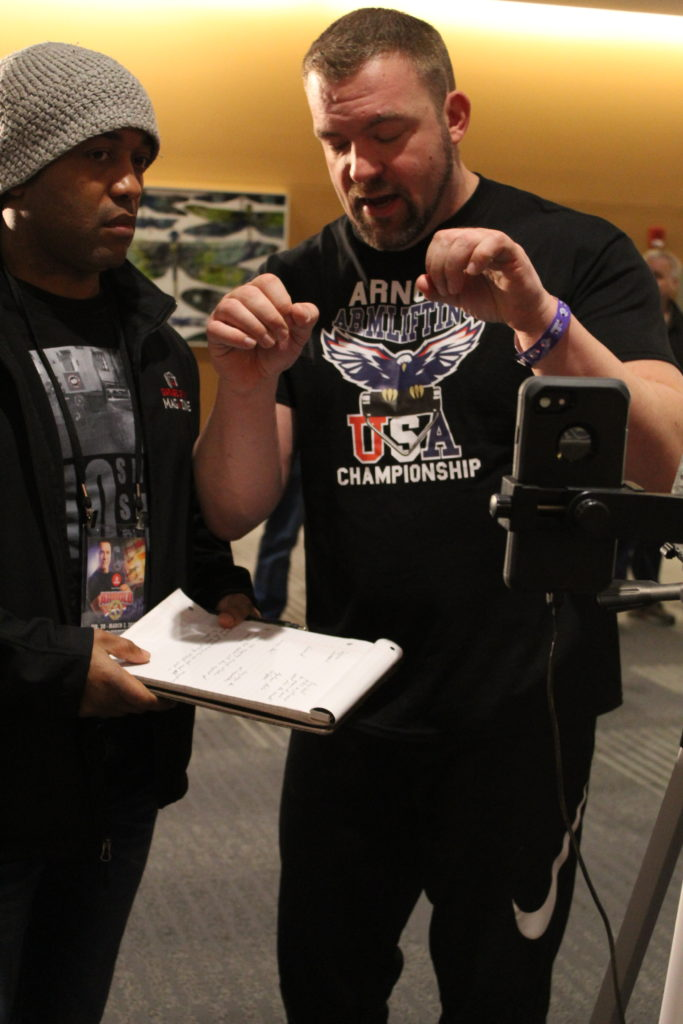 Jedd Johnson explaining the rules during the livestream of the 2019 Arnold Armlifting Championships